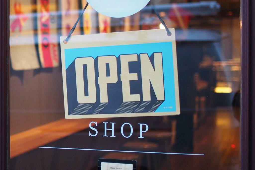 An OPEN sign on a shop door
